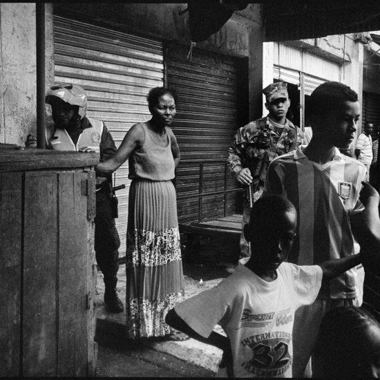 On-lookers at murder scene Galerías market area.